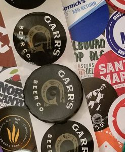 various custom printed keg cap stickers in a collage