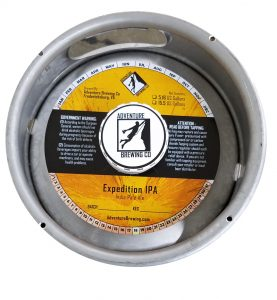 actual printed sample of a 4 color keg collar for Adventure Brewing placed on a sixth barrel