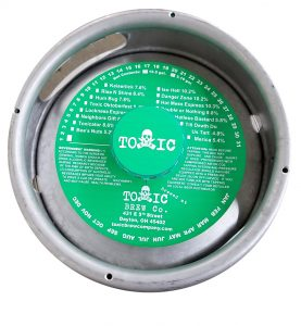 actual printed sample of a 1 color keg collar for Toxic Brewing placed on a sixth barrel