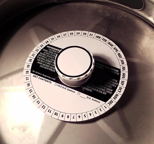 7 inch full size stock keg collar placed on 1/2 barrel keg