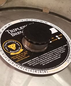 Custom printed 2 color keg collar placed on keg with black keg cap