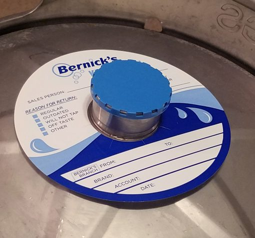 custom printed 2 color keg color on waterproof stock placed on a keg with blue vented keg cap