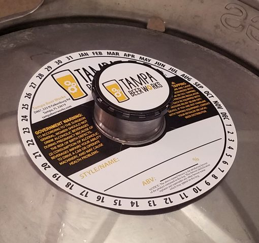 custom printed 2 color keg collar placed on keg with black keg cap and keg cap sticker