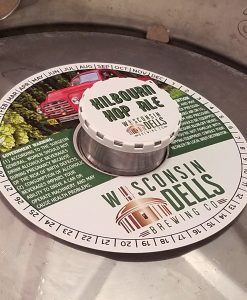 custom printed 4 color digital keg collar placed on a keg with white keg cap and keg cap sticker