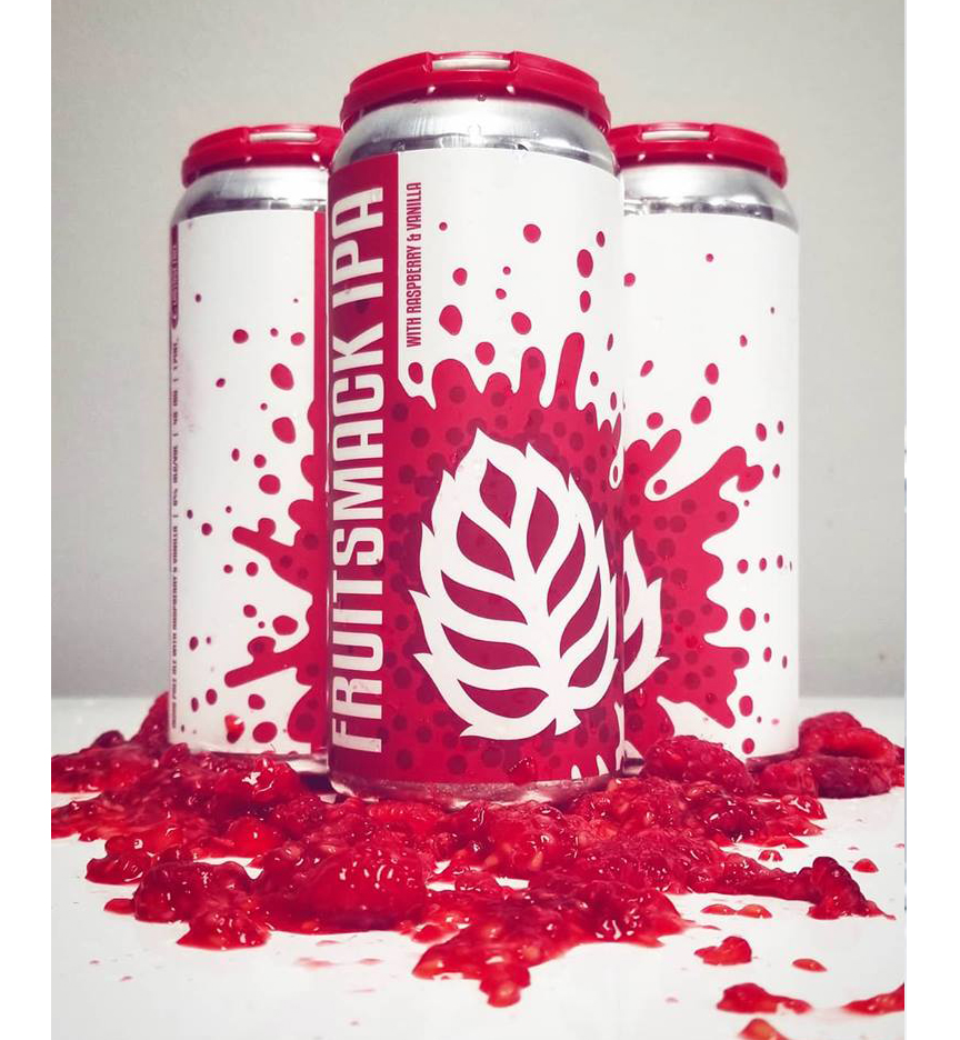 Fruitsmack 16 oz. can label installed on can grouped with raspberries and strawberries